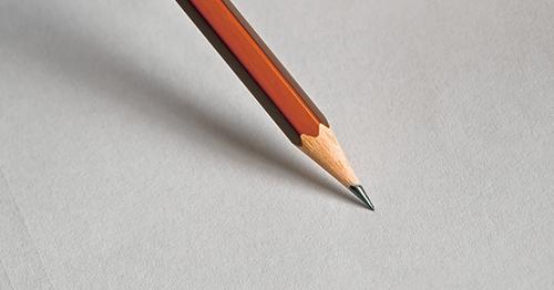 Foto Ein Bleistift auf einem Blatt Papier